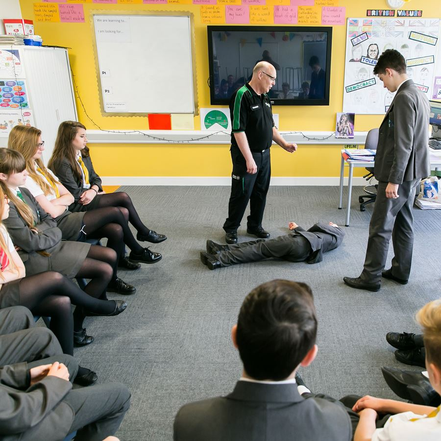 A class of secondary school pupils learning first aid