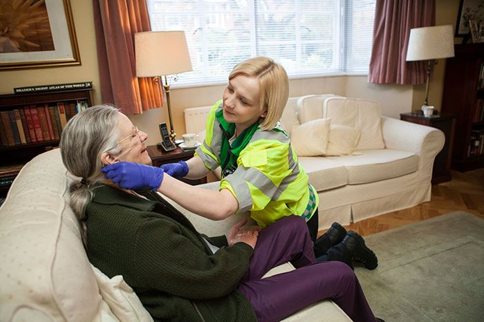 St John Ambulance Community First Responder helping patient