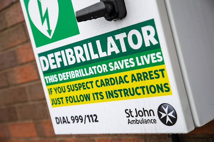 St John Ambulance defibrillator cabinet with instructions