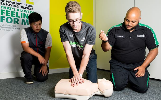 First aider teaching CPR