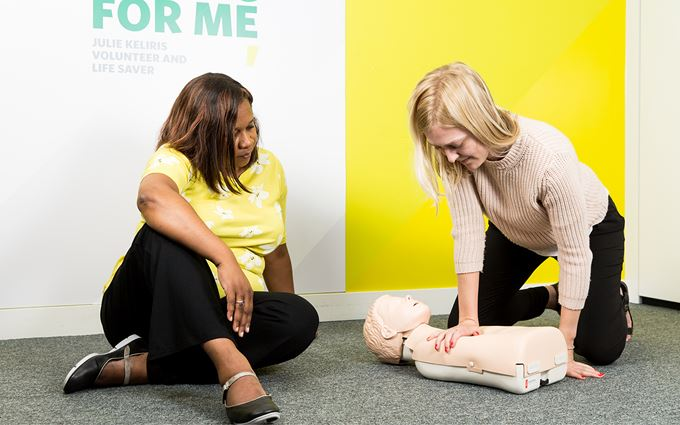 Course participants practicing child CPR using a training mannequin