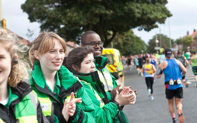 First Aiders cheering on runners