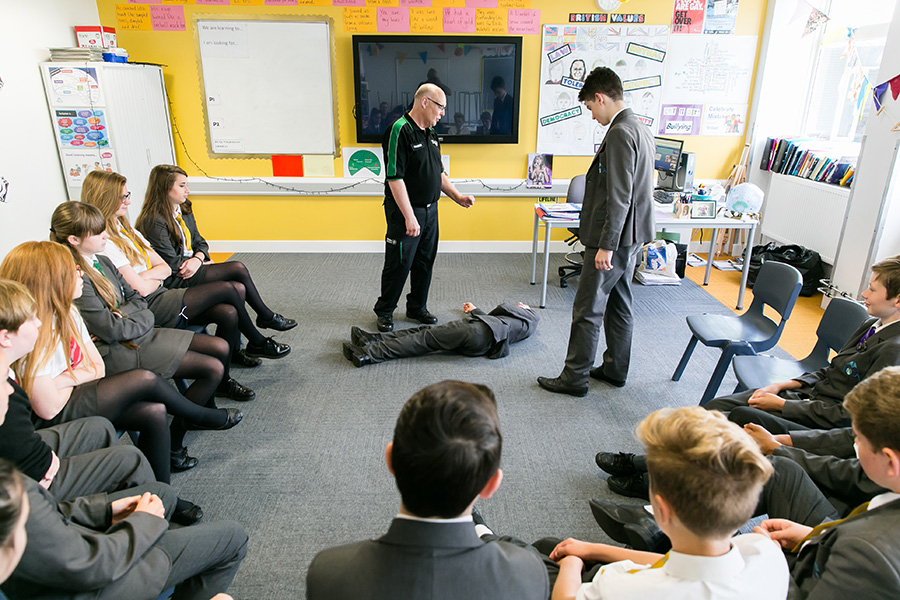 School pupils learning what to do in an emergency