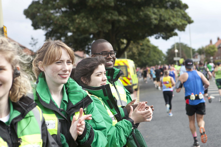 Volunteers support runners at event