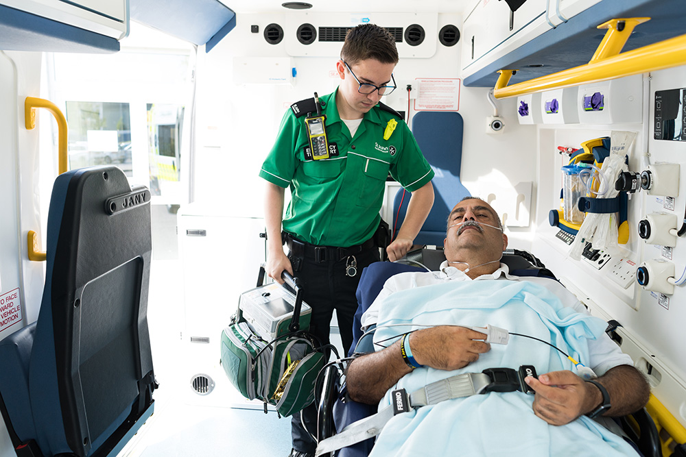 St John Ambulance crew member looking after patient
