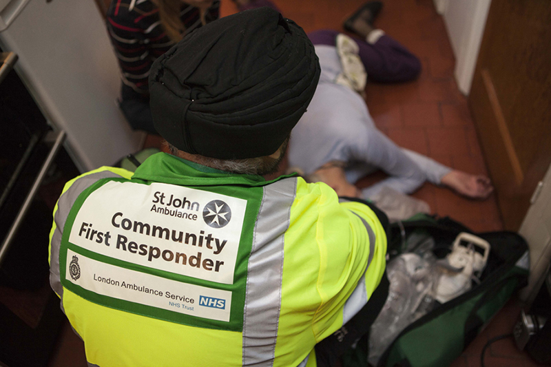 Community first responder helps a patient