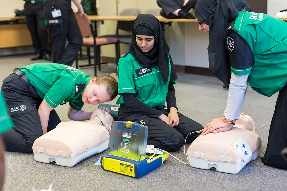 Peer educator teaching first aid