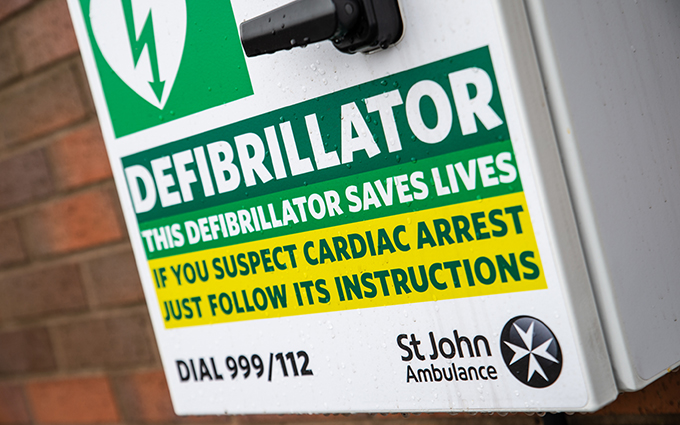 St John Ambulance defibrillator cabinet on a wall