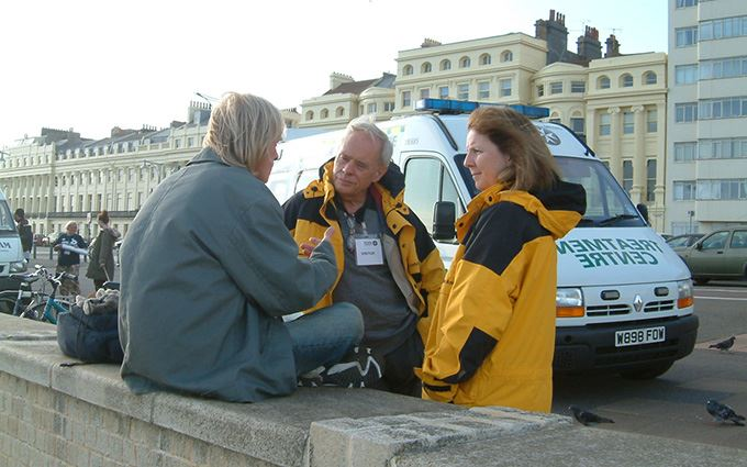 Brighton Homeless Service volunteers talking to man