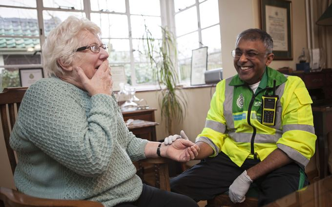 Community First Responder with elderly lady
