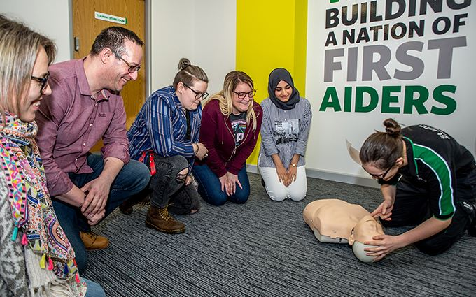 A St John Ambulance first aid trainer teaching CPR
