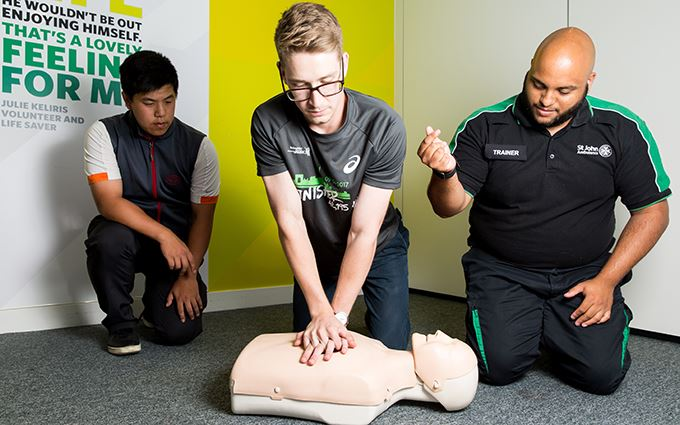 First aid course participants practicing CPR