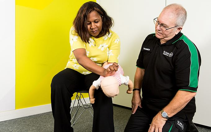First aid participants learning how to help a choking baby