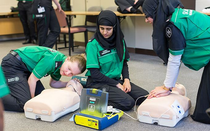 Cadets practising with AED